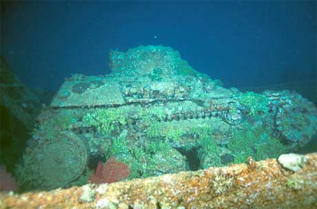 Japanese 2-man midget tank on the deck of the Nippo Maru wreck, Truk Lagoon, Micronesia. Image taken by Clark Anderson/Aquaimages.