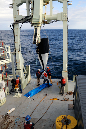 The sediment traps were placed at several locations across the North Atlantic, including the Sargasso Sea, the subarctic North Atlantic near Iceland, and the western North Atlantic near Massachusetts. The traps were submerged at depths of 150 meters for 24 hours and then the collected particles were analyzed in the lab. (Photo by Suni Shah, Woods Hole Oceanographic Institution)