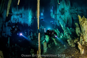 Divers exploring the Nohoch Nah Chich cave in Yucatan, Mexico