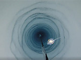 A British Antarctic Survey camera travelling down a 900-meter-long bore hole in the Filchner-Ronne ice shelf