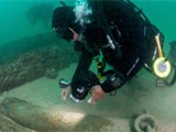 Marine archeology : diver and shipwreck