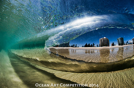Through a breaking wave on the Gold Coast Australia. Best in show awarding winning photo by Ray Collins.
