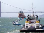 Ships tow ocean cleanup system